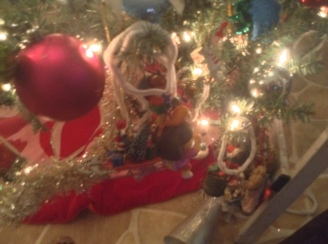 Izzy really focused on these two branches - yes there are 19 ornaments in that one spot!